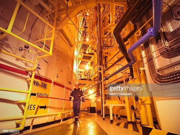 Engineer on walk way near reactor hall of nuclear power station