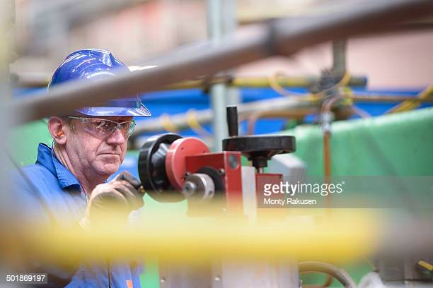 engineer operating boring machine during power station outage - monty rakusen stock photos and pictures