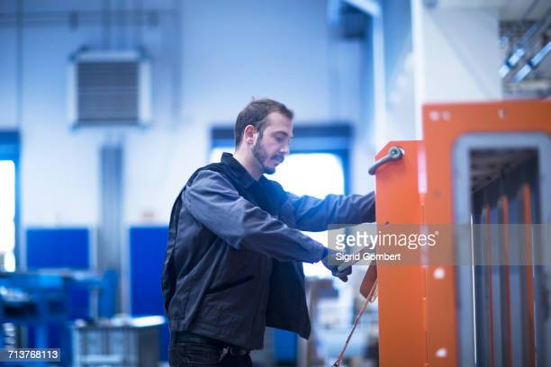 engineer operating heavy machinery - sigrid gombert stock-fotos und bilder