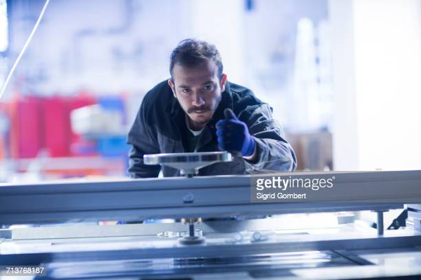 engineer operating heavy machinery - mechanical engineering stock pictures, royalty-free photos & images