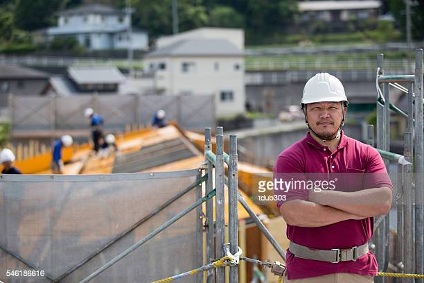 engineer or inspector at a building construction site - civil engineering stock pictures, royalty-free photos & images