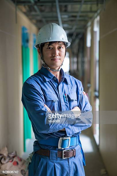engineer or inspector at building construction site - civil engineering stock pictures, royalty-free photos & images