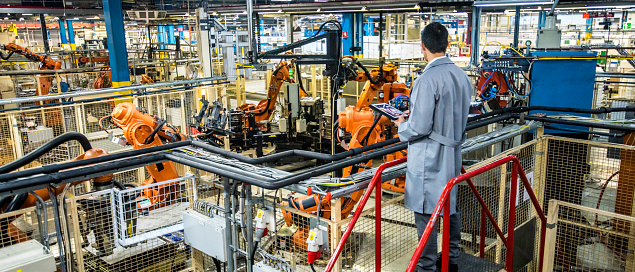 Engineer overseeing automated production process in a factory 1152220713