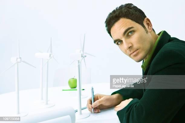 Engineer planning wind turbines area