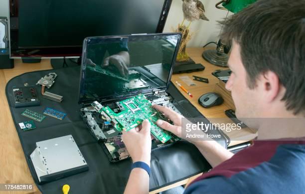 Engineer Repairing a Laptop