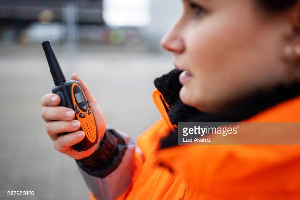 engineer reporting via walkie-talkie - radio stock pictures, royalty-free photos & images