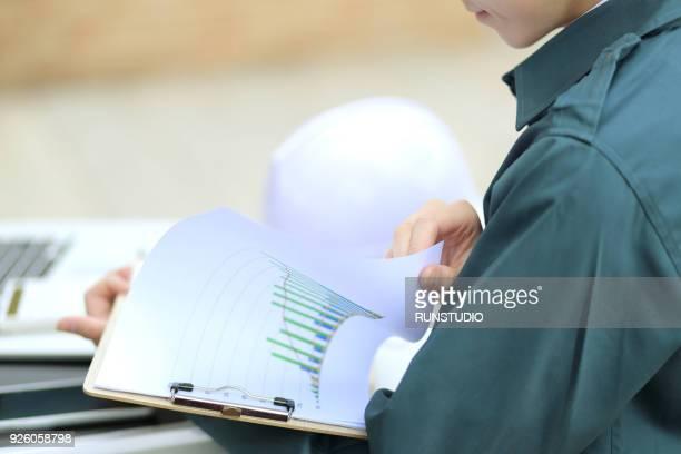 Engineer reviewing paperwork on desk