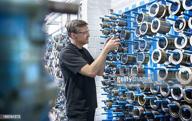 Engineer selecting industrial tools in engineering factory