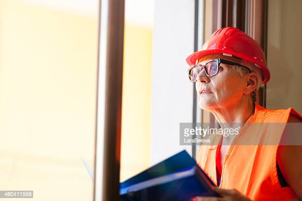 Engineer senior woman in protective workwear