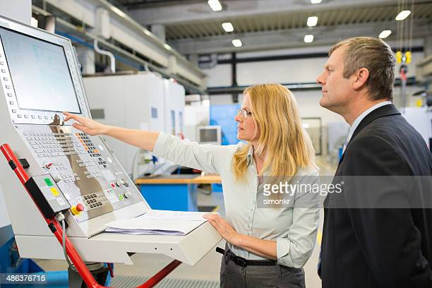 engineer showing a cnc machine - mechatronics stock pictures, royalty-free photos & images
