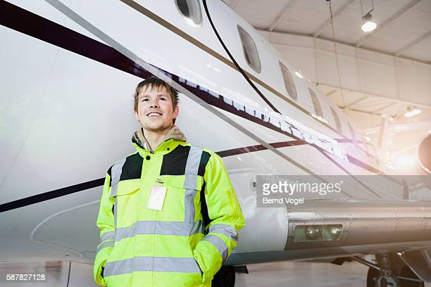 engineer standing by airplane at factory - aircraft assembly plant stock pictures, royalty-free photos & images