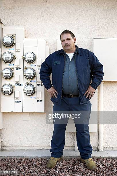 engineer standing in front of power gauges for utilities - machos - fotografias e filmes do acervo