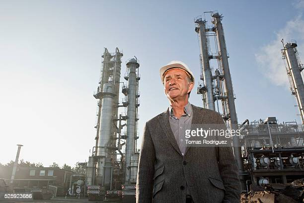 Engineer standing near chemical plant