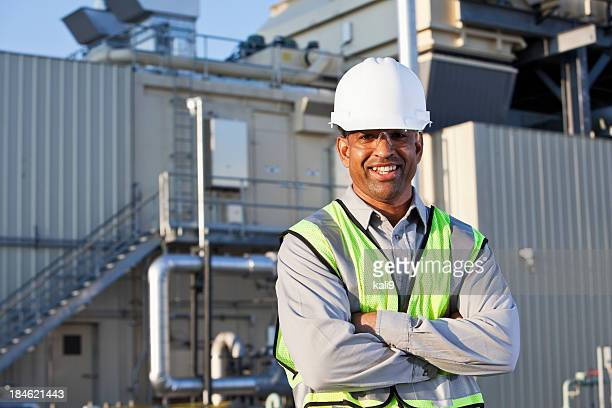 engineer standing near power generator - power station stock pictures, royalty-free photos & images