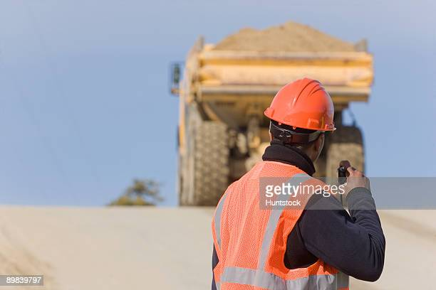 Engineer talking on a walkie-talkie