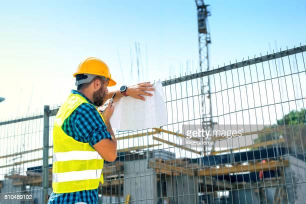 Engineer talking on walkie-talkie
