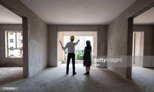 engineer talking the structure of the house with homeowner - council flat stock pictures, royalty-free photos & images