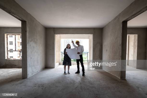 engineer talking the structure of the house with homeowner - real estate stock pictures, royalty-free photos & images