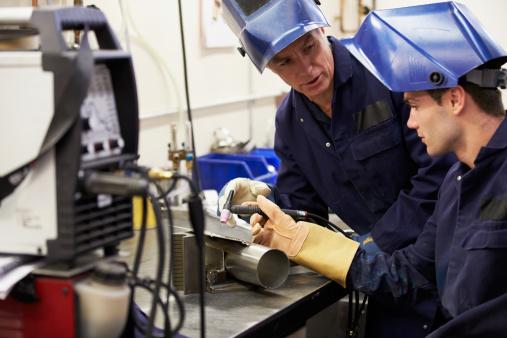 Engineer Teaching Apprentice To Use TIG Welding Machine 460180957