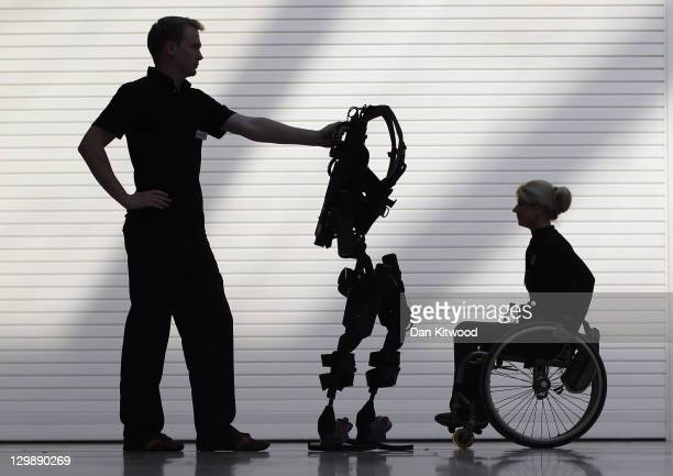 Engineer Thomas Dwyer stands with the new Bionic Exoskeleton next to Amanda Boxtel during its launch at the Excel centre on October 21 2011 in London...