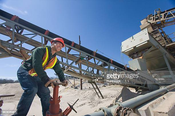Engineer turning valve at a gravel and asphalt plant
