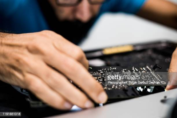 it engineer upgrading / repairing the computer - repairing stock pictures, royalty-free photos & images