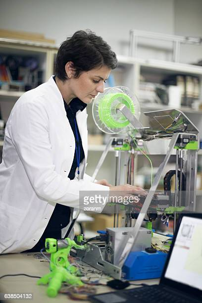Engineer using 3D printer
