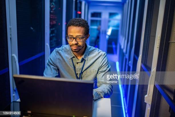 IT engineer using laptop