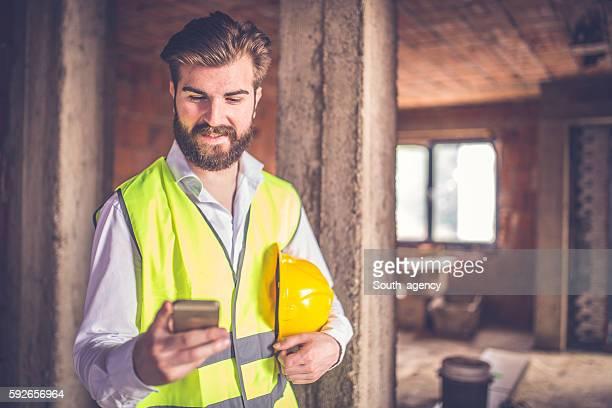 Engineer using smart phone