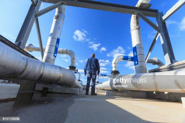 Engineer walking through water treatment plant