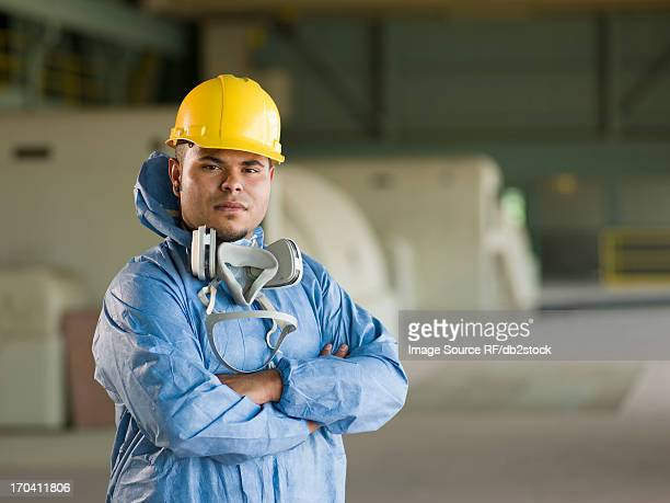 engineer wearing protective suit on site - protective suit stock pictures, royalty-free photos & images