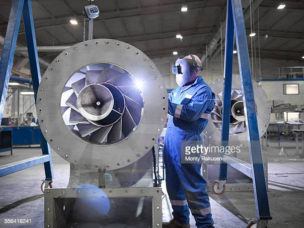 engineer welding airduct part in engineering factory - accuracy stock pictures, royalty-free photos & images
