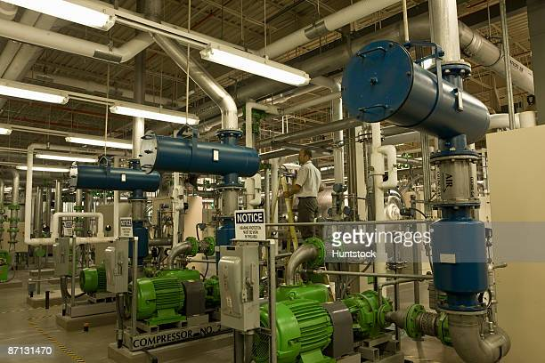 Engineer with air compressors in water treatment plant