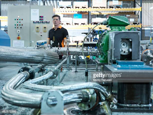 engineer with industrial pump testing rig in factory - monty rakusen stock pictures, royalty-free photos & images