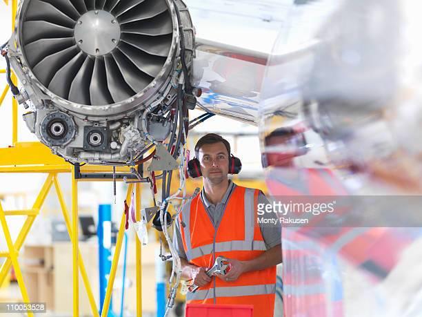 Engineer with jet engine