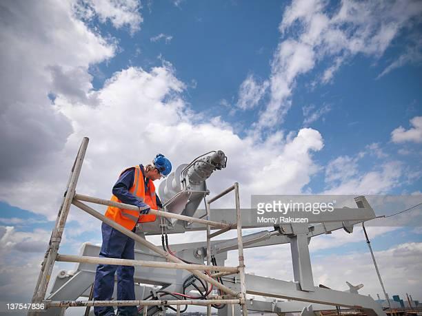 engineer with lifeboat assembly in shipbuilding industry - monty rakusen stock-fotos und bilder