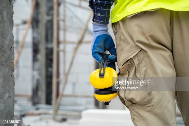 engineer with soundproof headphones. - hearing protection stock pictures, royalty-free photos & images