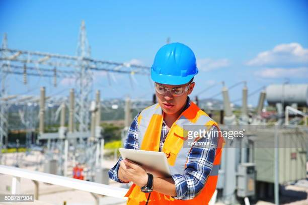 Engineer with tablet and Electricity