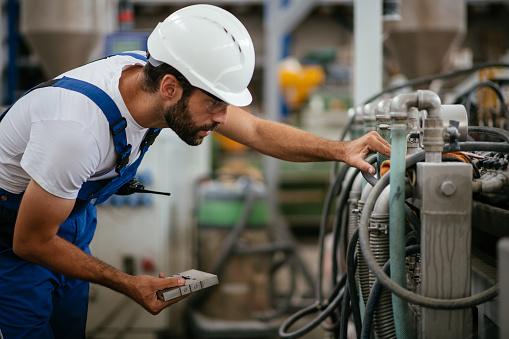 Engineer with walkie-talkie 1028457502