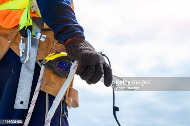 engineer worker wearing safety line working at high place. - protective sportswear stock pictures, royalty-free photos & images