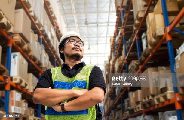 Engineer working and standing in new warehouse