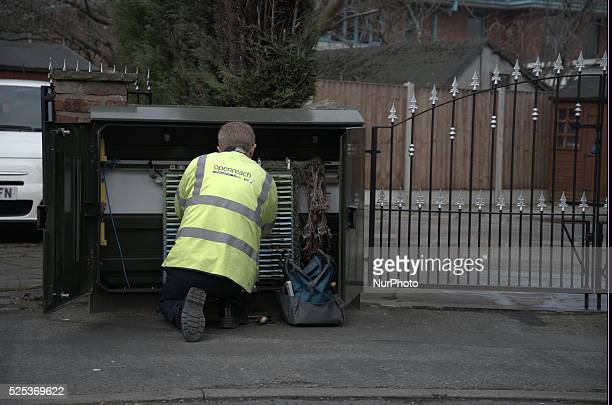 A BT engineer working at a junction box installing equipment on Friday 20th March 2015 in Stockport