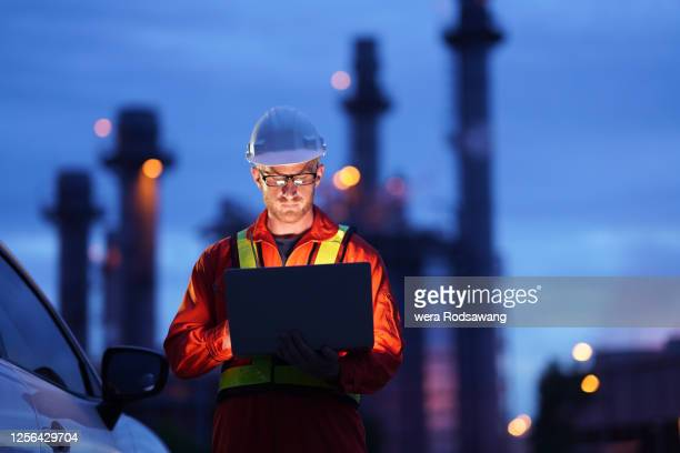 engineer working at construction power plant - manufacturing stock pictures, royalty-free photos & images