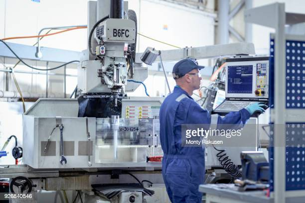 Engineer working at lathe in turbine maintenance factory