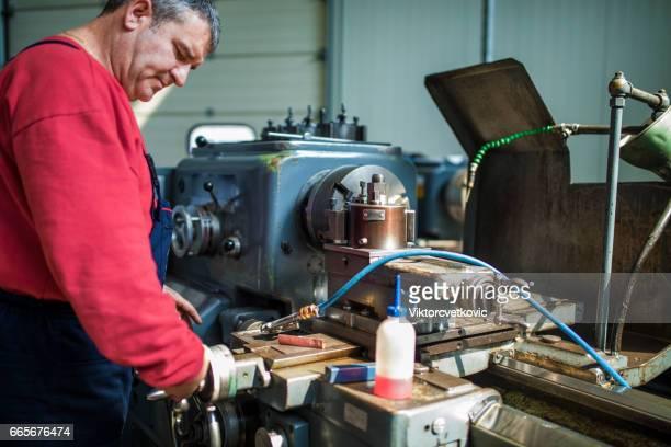 Engineer working at lathe