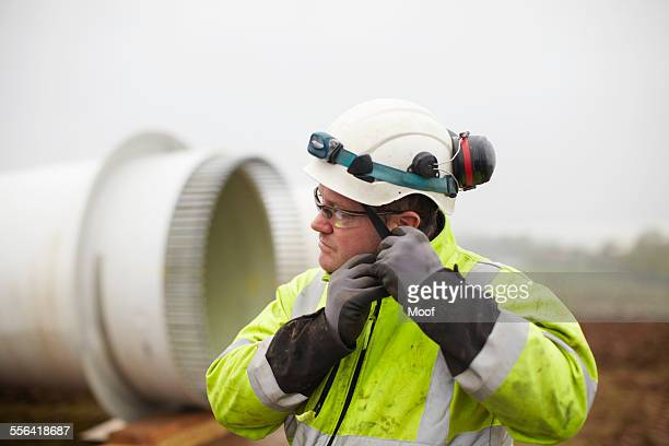 engineer working at wind farm - glove stock pictures, royalty-free photos & images