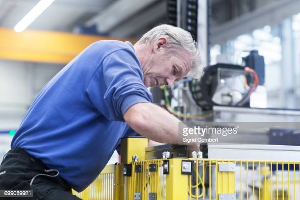 engineer working in engineering plant - sigrid gombert stock pictures, royalty-free photos & images