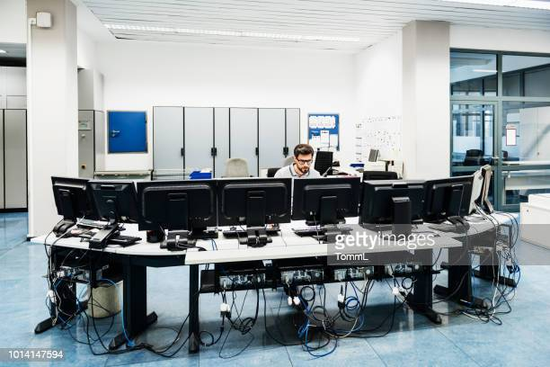 engineer working in factory control room - data center stock pictures, royalty-free photos & images