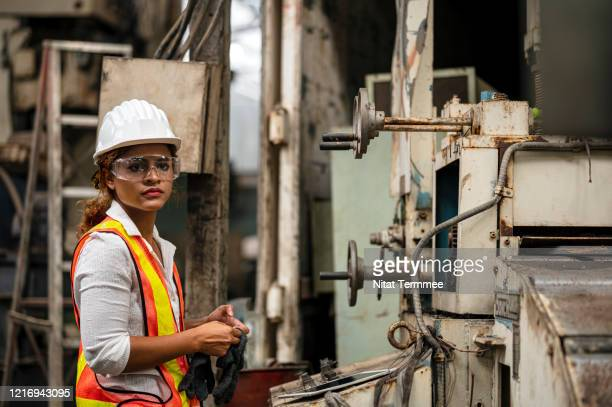 engineer working in old machine sorting center. maintenance engineer daily observing machine breakdown at factory facility. - waste management stock pictures, royalty-free photos & images