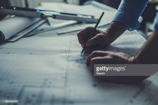 engineer working late - engineering stock pictures, royalty-free photos & images